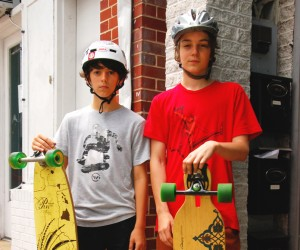 "(L to R): ""If you're entered in sliding for longboarding, there's definitely sliding gloves you should wear... and you can pick your own style,"" Atlas Pike, 12; ""I just like to dress cool, and also it's nice to just have durable clothes, 'cause if you fall it can get nasty. I tend to go for subtle gray,"" Oliver McDearman, 13"