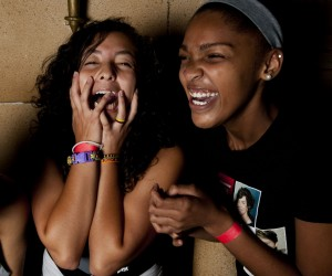 "Camila Rudas, left, and Chantelece Sutton showed their excitement before the start of One Direction's new film ""One Direction: This Is Us"" at the Arundel Mills Cinemark Egyptian 24. photo by Noah Scialom"