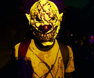 A bloody clown greets the guests.