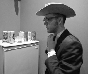 George Cessna getting dressed in his western suit before a show in Kansas.